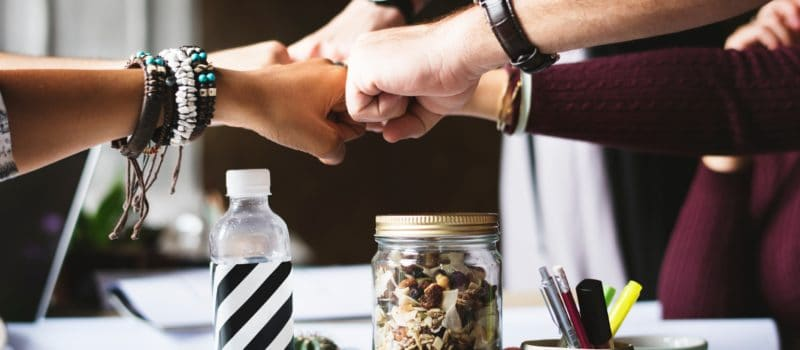 Employees punch it out after successful meeting