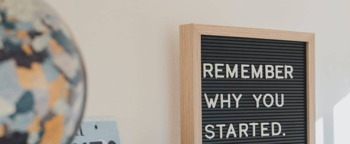 Remember Why You Started Sign Sitting on Shelf